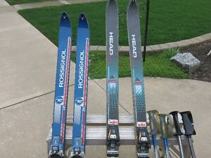 2 pairs skis, boots, poles