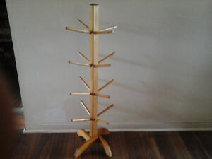 """Solid wood stand with 16 secure pegs. 40"""" tall. Great condition."""