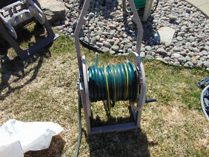 50 feet hose and roll with sprinkler $45  450-628-4656  514-803