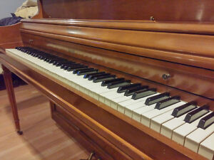 apartment sized, console piano. delivery and tuning included.