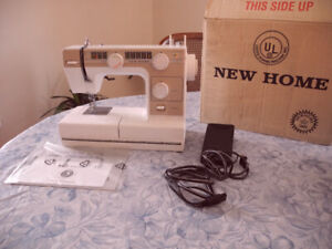 Janome L-372 New Home Sewing Machine in factory box.