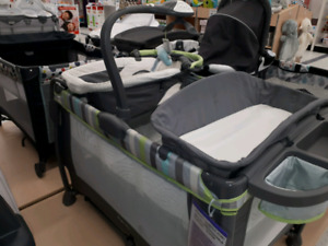 Bassinet, play pen,with napper and changing pad