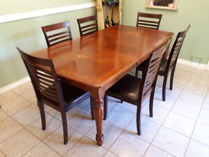 Table and 6 chairs.  Solid wood great condition $500