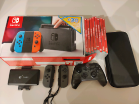 Nintendo Switch 32GB + 64GBsd + Games and many more