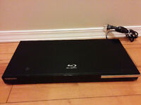 Samsung Blu-Ray Player with remote and 5 Blu-Ray Movies