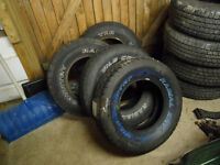 2 - LIKE NEW 235/75/15 WILD COUNTRY WHITE LETTERED TIRES