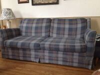 Sturdy love seat with hide away bed