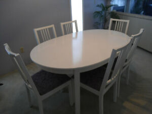 """White dining table ( 60 """" - 84"""" long)  and 6 chairs."""