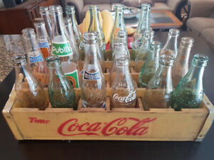 Antique bottles and Coca Cola wooden crate