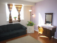 Female only-$650- A large bright bedroom in Condo Apr-