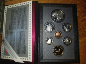 1996 silver coin set complete with card and box 226-448-9639...
