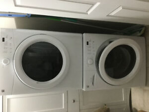 Full size Kenmore washer and dryer with stacking kit included.