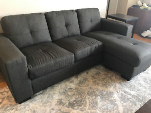 Sofa with attached chaise.