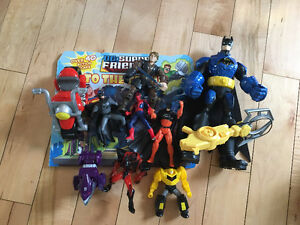 Batman action figure and other super heros