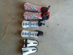 Several soccer shin pads