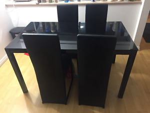 Black dining table with 4 chairs.