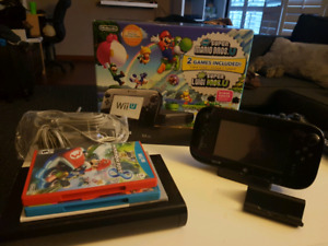 Wii u with two games in original box