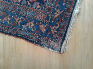 Several hand made rugs, mostly well used.  Small to medium sizes