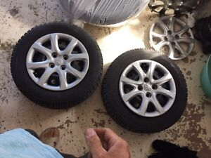 4 winter tires hub caps and bolts for sale