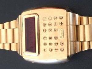 Pulsar 18K solid gold time computer calculator watch & gold pen