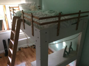 Loft bed with shelving and desk underneath