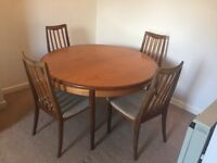 Extendable kitchen dining table and chairs