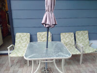 atio table with 4 chairs and umbrella