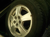 Three 15 inch chev rims and 195/65/15 M+S tires. $75 for all