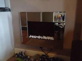 Wall hung electric mirrored fireplace