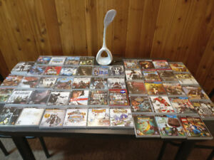 PS3 (500gb Hard Drive), 3 Controllers, 50 Games