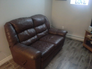 Brown leather recliner loveseat and T.V