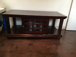 Mahogany color coffee table with glass front