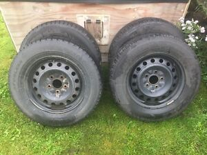 """4 winter tires for sale with 16"""" rims 225 65r16 $450"""