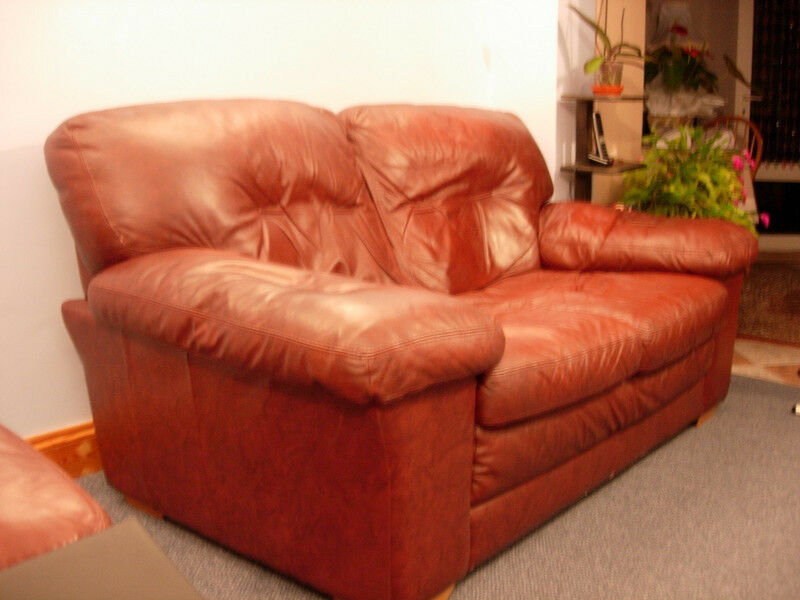 Two Dark Red Leather Sofa Plus A Large Pouffe For