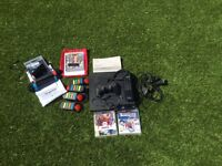 PS 3 slim with games, sing star mic's and Buzz