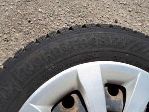 4 pneus d'hiver nordfrost 200 monté sur rims 185 185-65r15