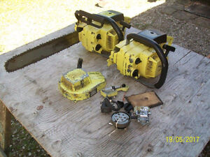 Two Pioneer P26 chainsaws