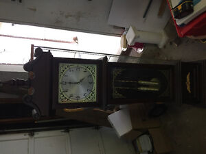 Grandfather clock and ironing board
