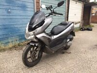 2012 Honda PCX 125cc learner legal 125 cc scooter. Runs excellent. Cosmetic repairs needed.