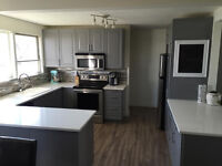 FULLY RENOVATED HOME IN WEST PARK WITH LARGE GARAGE