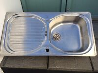 Stainless steel sink with drainage board