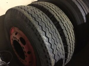 2. 9.00x20 tires and rims $100 for pair