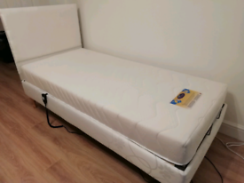 Single Adjustable Bed and Memory Foam Mattress.. Brand New