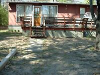 two bed cottage for sale Tiny Township on the Lake please contac