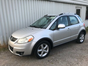 2009 SUZUKI  SX4 , TOURING,  AWD, ONE OWNER  CAR .