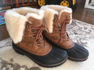 Brand new women's winter boots size 11