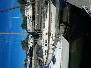 1980 Hughes 31 ft Sailboat with sails,outboard engine and cradle