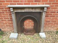Cast iron fireplace with wooden surround.