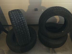 255/65/17 Arctic claw studded winter tires