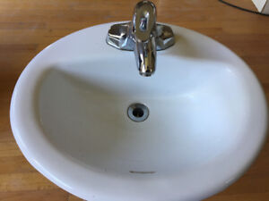 Used vitreous china vanity sink